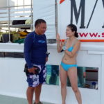 dive-master-and-guest on Tubbataha diving boat